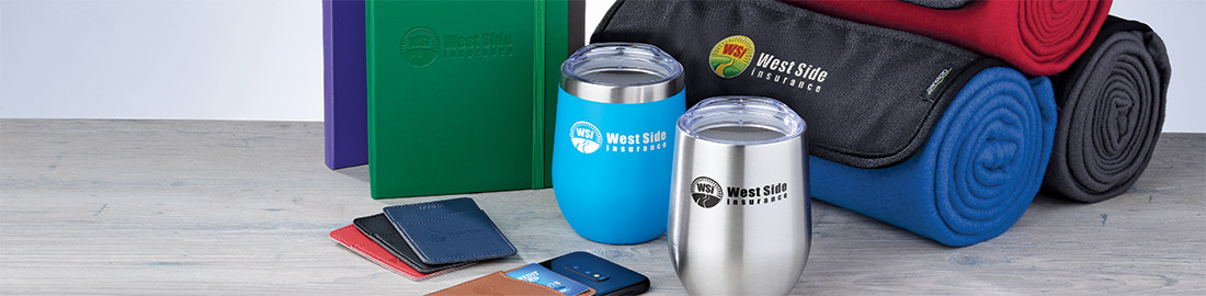 Business Gifts that include coffee tumblers, notebooks and blankets